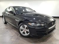 This 2018 Jaguar XE 25t is featured in with interior.