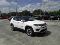 This Jeep Compass Limited 4x4 in a bright white