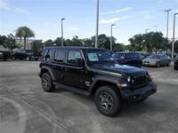 This Jeep Wrangler Unlimited sport 4x4 in black with