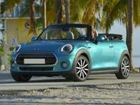 Open roads and open skies make this 2018 MINI Cooper
