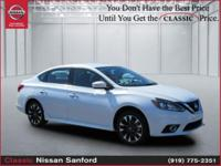 This 2018 Nissan Sentra SR is Aspen White with a