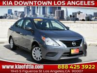Clean CARFAX. Gray 2018 Nissan Versa 1.6 SV 4D Sedan