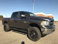 This 2018 Ram 1500 4dr SLT features a 5.7L 8 Cylinder