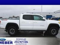 White 2018 Toyota Tacoma 4WD. Odometer is 7055 miles