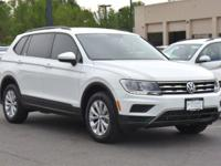 This turbocharged Pure White 2018 Tiguan S comes with