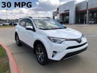 2018 Toyota RAV4 in Super White exterior and Taupe