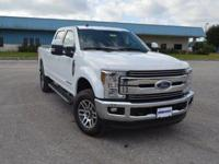 This spotless, low mileage Ford F250 Lariat CrewCab 4x4