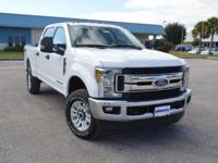 This spotless, low mileage Ford F250 XLT CrewCab 4x4