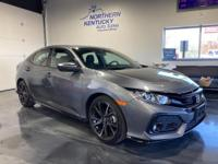 This 2019 Honda Civic Sport Hatchback has a 1.5 liter,