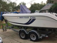 I am selling a Cobia 204 center console. It's a 1999