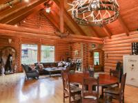 .This beautiful 6 bd, 4 bath custom Neville log home