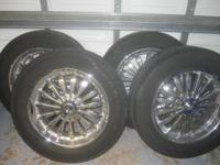 "Set of (4) 20"" Chrome Falken Rims six holes, and tires."