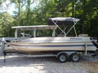 20ft 2000 Fisher Deck Boat with 125hp Mercury. Priced