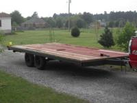 "It is a 101""x 21' flatbed trailer with double axles, 2"