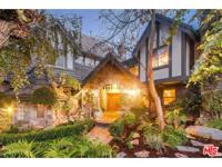 Enchanted, gated Storybook Tudor estate with views to