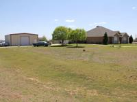 3 br 2 bath 2 living areas on 1.01 acres. The second