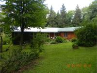Beautiful three bedroom ranch nestled in the woods on