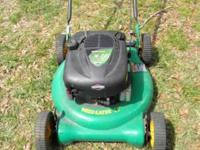 "Selling lightly used 21"" cut push weed eater lawn mower"