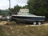 21ft. dual axle trailer with junk boat and Mercruiser