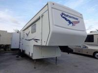Up for sale is this 2005 Potomac fifth Wheel with four