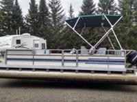 Harris 22' pontoon boat with trailer and 60hp mercury