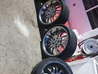 22 inch chrome rims and tires. Low profile tires. Tire