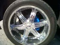 22 inch platinum rims, bad spot on one of them.. needs