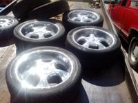 "4 22"" rims (6-holes, came off Chevy) with tires. $600"