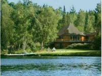 Beautiful Lake Front Chalet style home built in 1985.