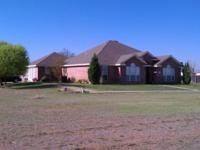 3 br 2 bath brick home sits on 1.01 acres on interior
