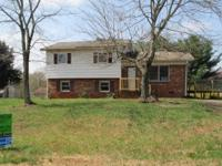 Visit this split level home in Newton! This property