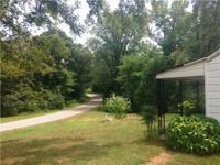. Older Fixer-upper 2BR, 1BA home on 16.8 acres m/l