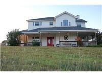 Gorgeous home with acreage, spring fed pond, bull pen,
