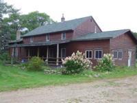 5 bedroom 2 bath house on 80 acres with half log