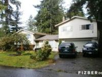 Large in-town dwelling with huge, treed backyard. This