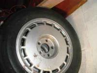 Set of 4 Goodyear Eagle GA tires mounted on Cadillac