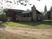 FOR SALE: House with numerous outhouses and 40 acres of