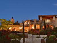 This magnificent estate in the coveted Rough Hollow
