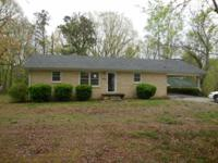 This 3 bedroom 1 bath home sits on over an acre lot.