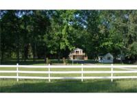 This 2 +/- acre property, with a gated entrance, is