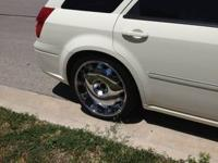 22 inch rims for sale w/tires. Two tires are still ok