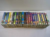 23 Disney VHS Tapes in White Clamshell Boxes.  The