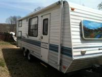 1997 23 foot coachmen sleep 6 has bunks in rear.