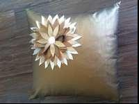 23 in sq gold leather decorative pillow with cut out