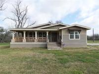 This beautiful 3 bedroom/2 bath home sits on just over