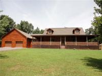 Beautiful Log cabin with 4 Br, 3 Ba on 5.50 acres that