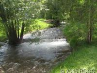 MLS #233320 A river runs through it.  28.79 acres