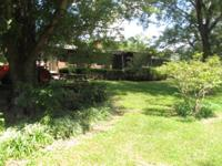 Beautiful 4 bedroom 3 bath brick home on 26.9 acres in