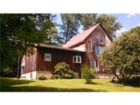 Two story rustic home on 13+/- acres built in 1994 w/