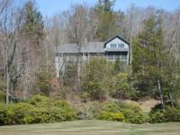 Located in the beautiful and prestigious Cullasaja Club